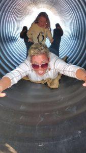 An adult enjoying the slide