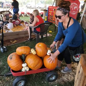 Loading up a wagon with pumpkins